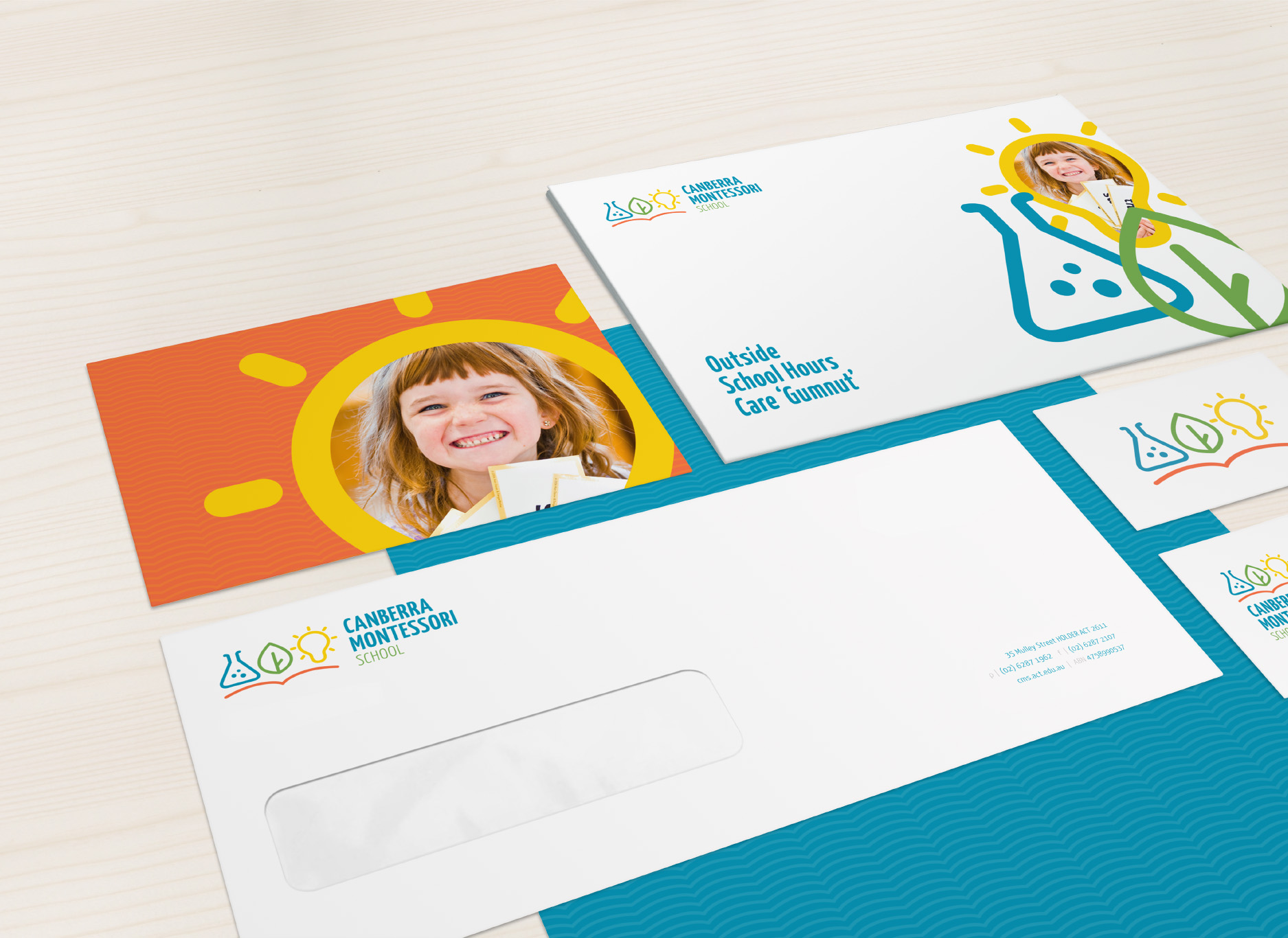 Image of a stationery set with envelope and business cards for Canberra Montessori school