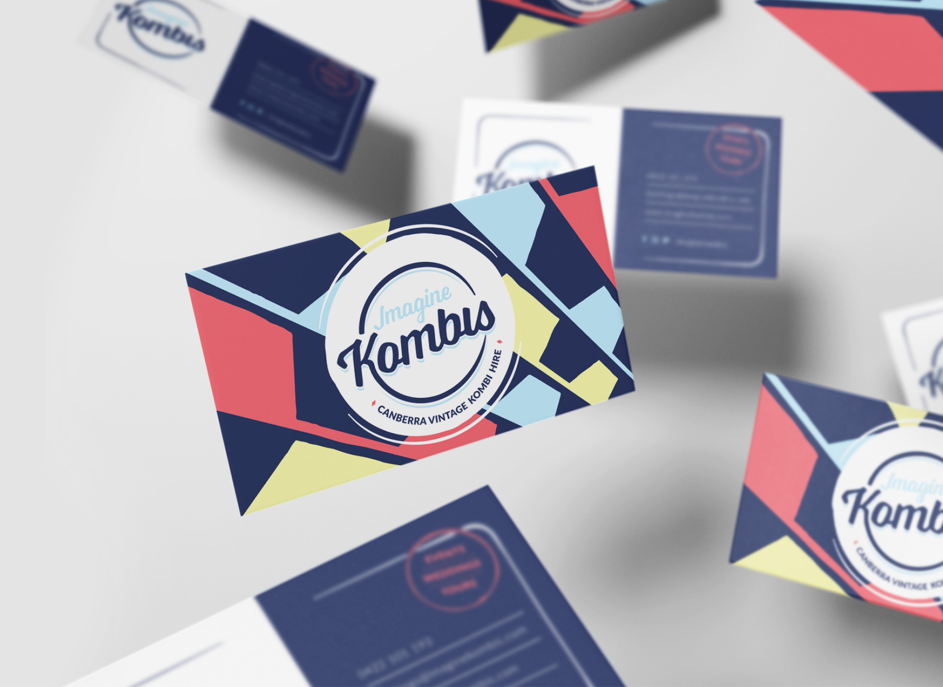 Image of Imagine Kombis business cards floating showing the back and front design