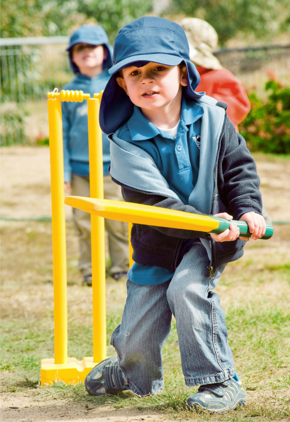 Image of a young student at Canberra Montessori School playing cricket