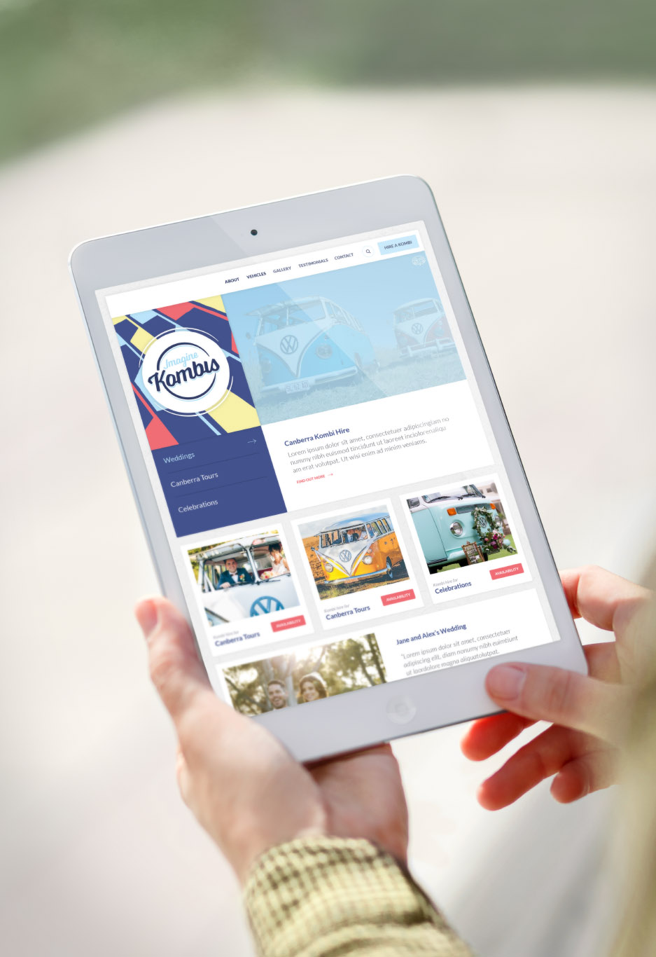 Person holding an I Pad mini showing Imagine Kombis website homepage artwork